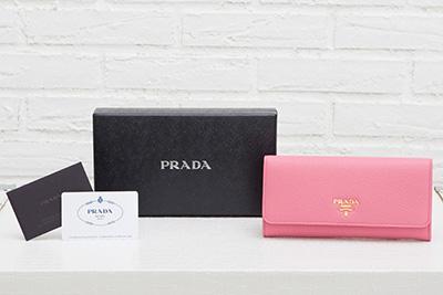 プラダ 長財布 スナップボタン カードホルダー ピンク ギャランティーカード 箱