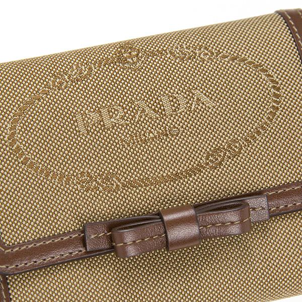 650c4976486a PRADAのロゴ&リボンが大人可愛い二つ折り財布 1MH523 LOGO JACQUARD ...